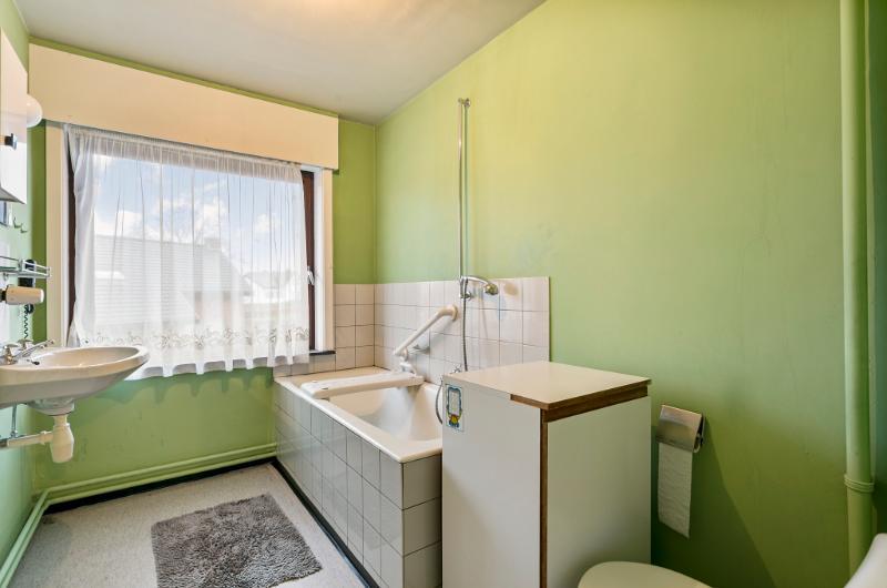 Kloeke woning in half open bebouwing in rustige woonwijk